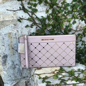 NWT Michael Kors XL Zip perforated Clutch pink